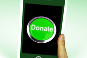A smartphone with a green donate button.