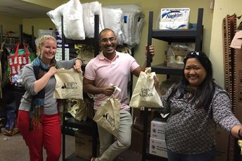 Bay Area Community Services staff pose with hygiene kits they received from Simply the Basics. (Simply The Basics)