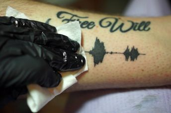 The tattoo can be linked to a sound clip of your loved one's voice. (Skin Motion)
