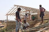 Paid Rohingya volunteers are helping with construction of the houses.