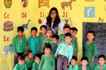 The author of this article with children in school. (Riyanka Roy)