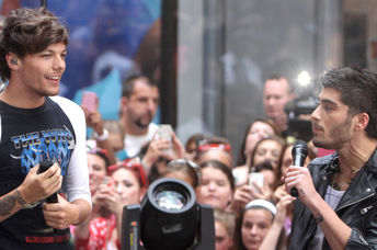 Louis Tomlinson and Zayn Malik of One Direction perform on NBC's Today Show at Rockefeller Plaza on August 23, 2013