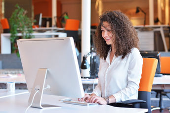 Happy woman at work (Shutterstock)