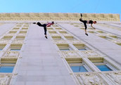 Dancers Amelia Rudolph and Roel Seeber soar through the air as they waltz on the walls of City Hall