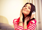 A woman listens to music (Shutterstock)