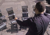 Composer Ljova directing the virtual orchestra on the streets of New York City