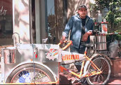 Alfonso Dominguez standing next to his El Taco food bike.