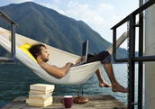 Man on hammock with laptop