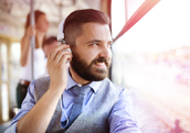 Man listening to podcast on bus