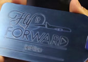 The official Flying it Forward luggage tag.