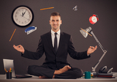 Businessman meditating desk office mindfulness