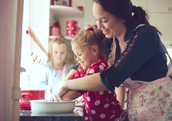 mom baking with daughters