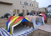 Cardborigami shelters on display at a Sleep out in Venice, California