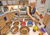 Sher Polvinale prepares food for elderly cats and dogs.