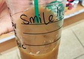 Starbucks drink with smile!! written on it