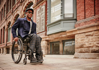 IZ clothing line model in wheelchair