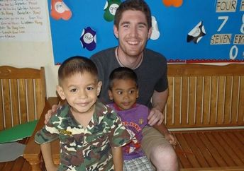Christian Clark with children at daycare in Thailand (courtesy of Projects Abroad)