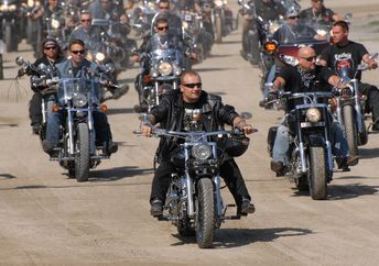 Members of motorcycle clubs ride together in large groups showing off their bikes (Marcel Jancovic/Shutterstock.com)