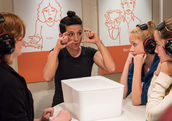 A facilitator explains sign language at a Dialogue in Silence exhibition in Hamburg. (G2 Barniak)