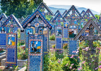 Painted wooden crosses in the famous Merry Cemetery in Maramures, Romania. (Danilovski / Shutterstock.com)