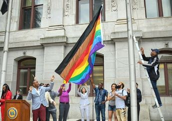 The flag, hoisted outside City Hall during a recent Pride Month event, was created as part of the More Color More Pride campaign, which aims to make non-white LGBTQ people more visible. (Kelly A. Burkhardt Photography/City of Philadelphia)