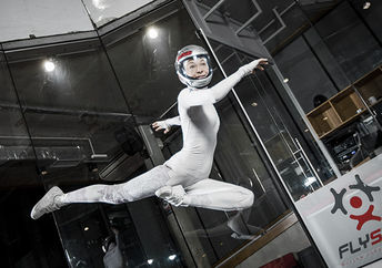 Inka Tiitto performs a dance routine in an indoor skydiving tunnel