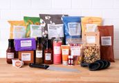 A selection of Brandless products are shown on a table