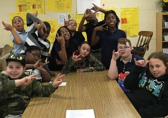 Students at Mark Bills Middle School in Peoria, Illinois created a sign language club to better communicate with a deaf student. (Tammy Arvin)
