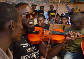 Young Kenyans play classical music together at the Art of Music Foundation Kenya