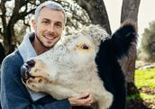 Nathan Runkle poses with a rescued cow