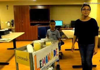 8-year-old Ulises Ornelas sells lemonade at the Madonna Rehabilitation Hospital in Lincoln, Nebraska