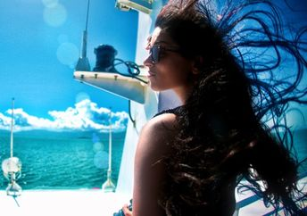 A woman looks out onto the horizon on a yacht near Koh Samiu Island