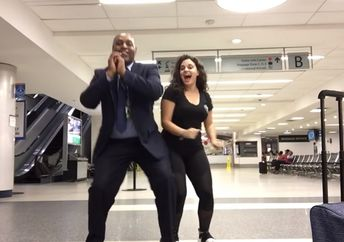 Mahshid Mazooji dances with airport workers after getting stranded at Charlotte International Airport