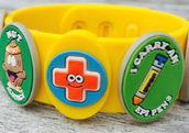 An Allermates allergy wristband with three of the 30 possible charms