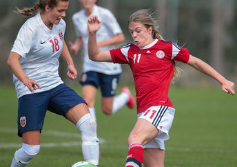 Andrea Norheim (#18 Norway) and Freja Kjaersig Sunesen (#11 Denmark) fight for the ball during a UEFA women's U17 qualifying game