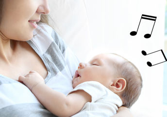 Young mother sings a lullaby to her baby.