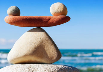 A photograph of stones in balance to convey work life balance