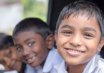 Happy, healthy Indian children smiling as they go to school.
