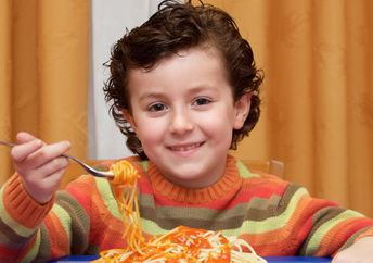 This boy is eating a healthy and nutritious kid-friendly meal.