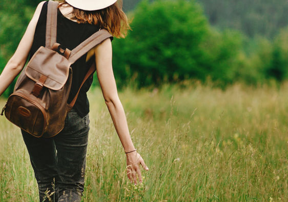 Woman walking outdoors to show intrinsic motivation