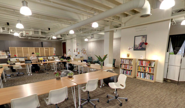 Coworking with soft lighting and the soothing sound of running water