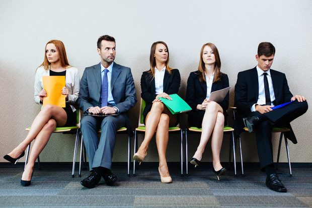 Prospective applicants waiting for their turn at a job interview.