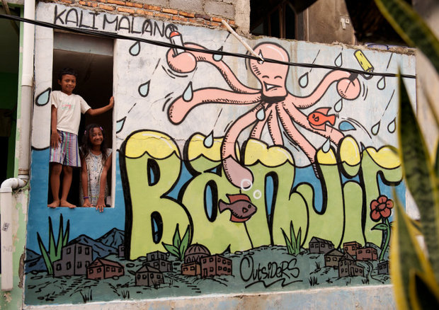 Graffiti art in Jakarta neighborhood courtesy of the project Share The Word