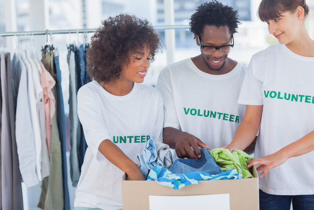 Volunteers taking clothing donations