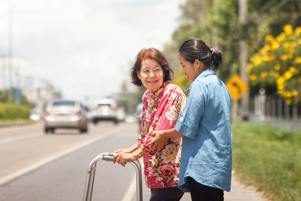 Helping an old woman across the road