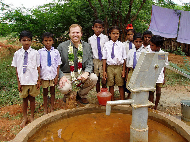 Water.org co-founder and CEO Gary White with the school water committee in Mettupatti, India.