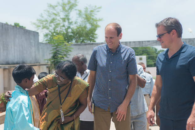 White and Damon meeting members of small communities in India (Water.org)