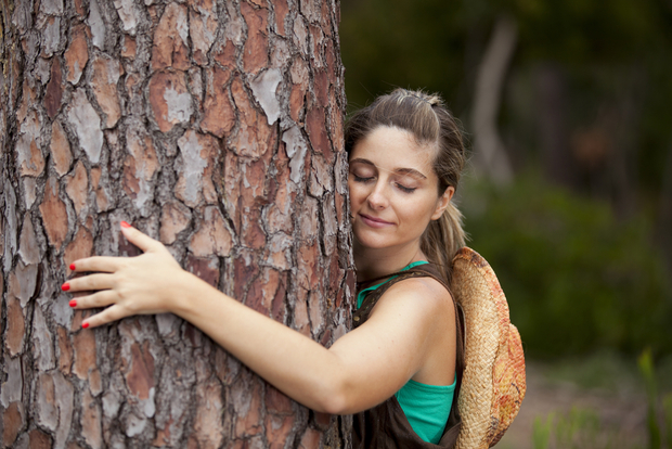 A girl hugging a tree