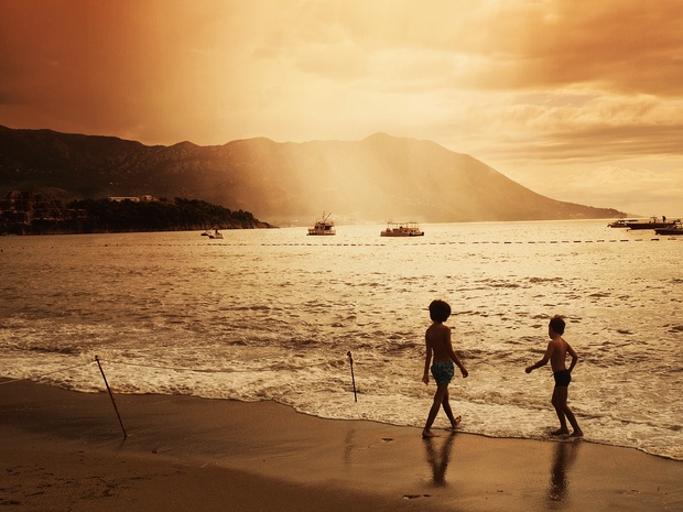 Happy healthy children playing on the beach