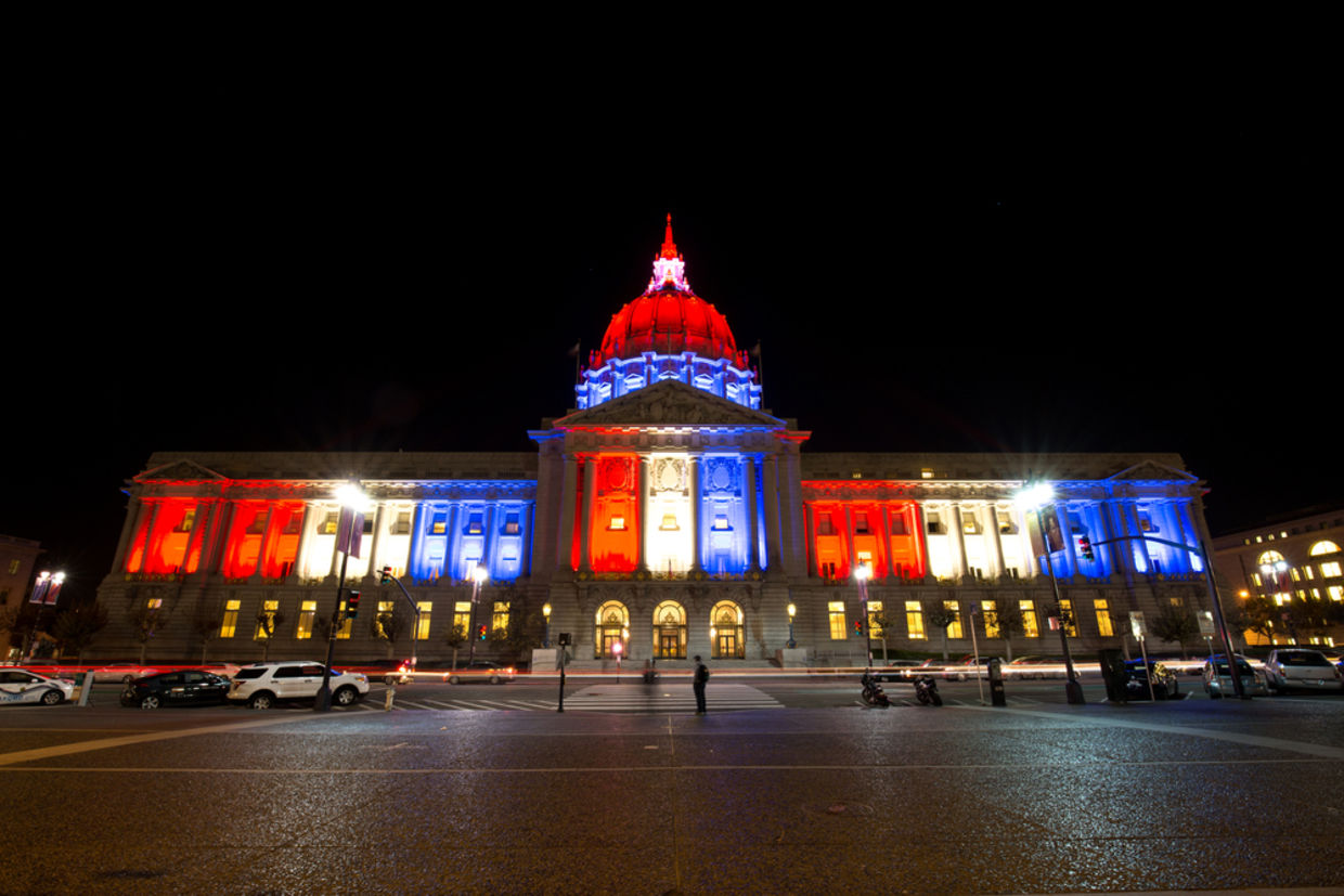The San Fransisco City Hall glows red white and blue in solidarity with Paris